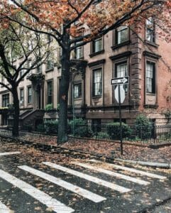 City Neighborhood Littered With Fall Leaves iPhone Wallpaper