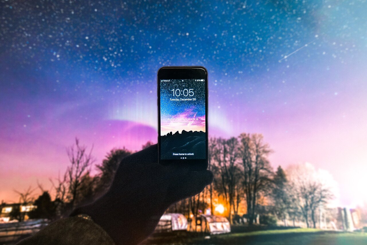 iPhone with Galaxy Wallpaper
