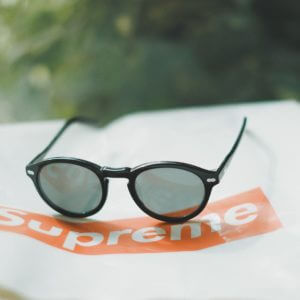 Sunglasses on Top of Supreme Logo